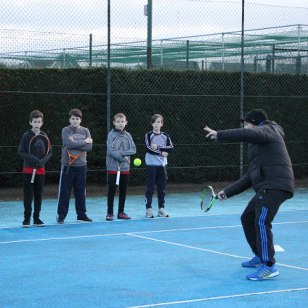 Tennis Club practice on the courts at KWMCC